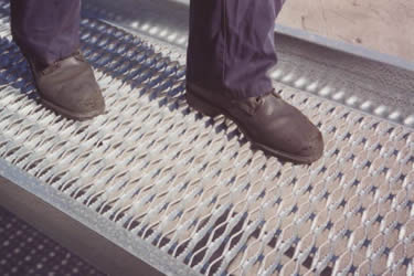 One people walk on galvanized diamond safety grating walkway