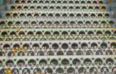 Many galvanized perforated-o safety grating stair treads installed outdoor