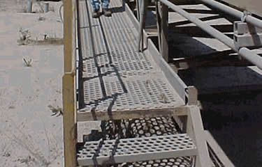 Perforated-o safety grating walkway installed on machines