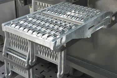Galvanized safety grating stair treads installed for machines